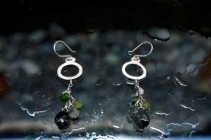 Hoop earrings with green stone